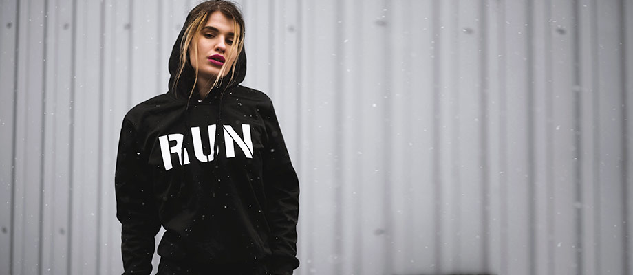 Woman wearing a hoodie with the word 'RUN' on the front